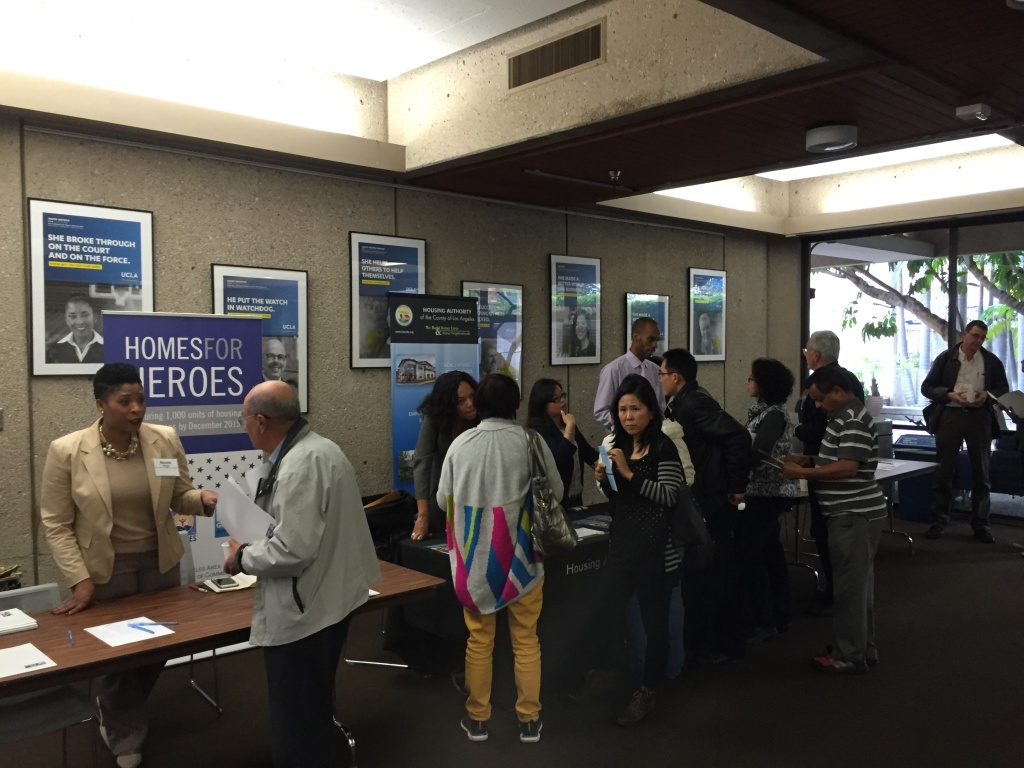 File: Workers from non-profit organizations talk with area landlords at a Department of Veterans Affairs event at UCLA. The VA wants more landlords to offer leases to homeless veterans with housing vouchers.