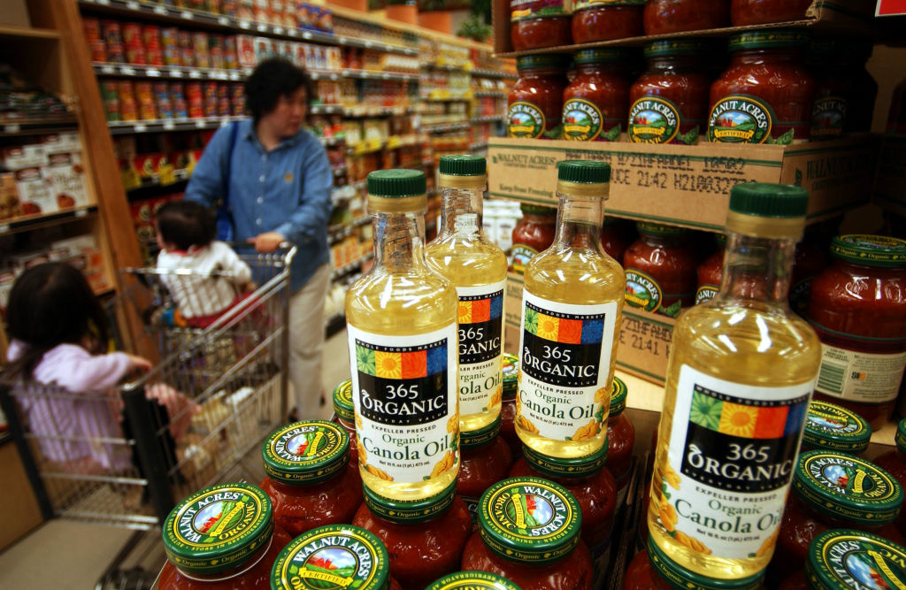 A shopper walks by organic products in a Whole Foods Market natural and organic food store, among the first to have USDA-certified organic products on October 21, 2002 in Tustin, California.