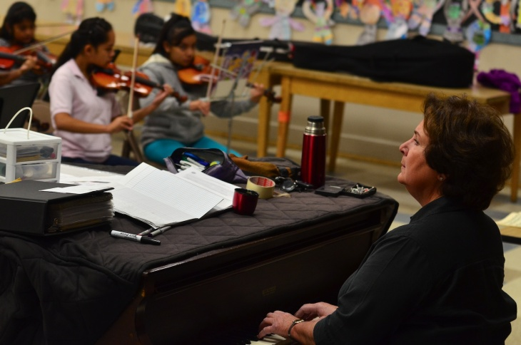 Stops are frequent for Linda Mouradian's elementary music class, she emphasizes technique with her students.