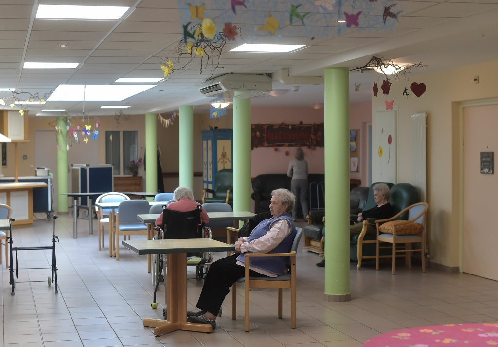 People with Alzheimer's sit in the refectory of a retirement home on October 18, 2016 in Saint Quirin, France.