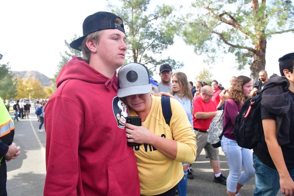 People react near Central Park after a shooting at Saugus High School in Santa Clarita, California on November 14, 2019.