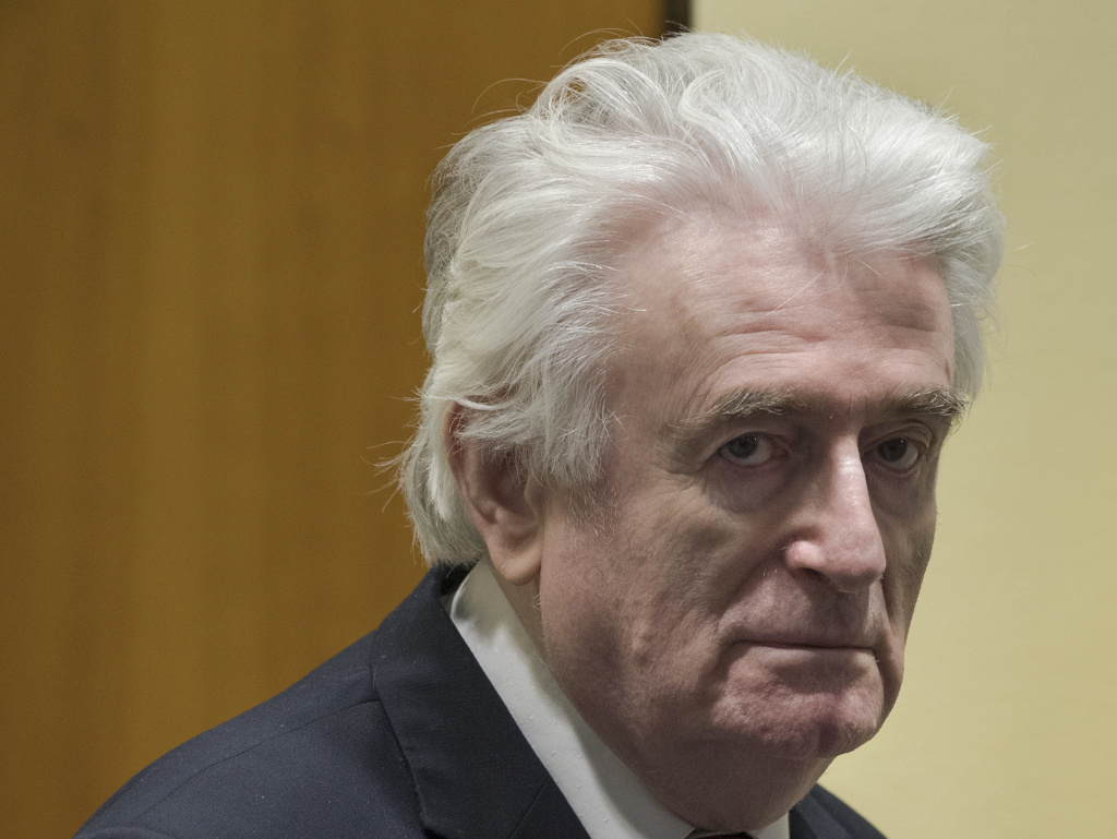 Former Bosnian Serb leader Radovan Karadzic enters the courtroom of the International Residual Mechanism for Criminal Tribunals in The Hague, Netherlands, on Wednesday.