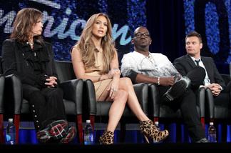 (L-R) Musicians Steven Tyler, Jennifer Lopez, producer Randy Jackson, and host Ryan Seacrest speak onstage during the 'American Idol' panel at the FOX Broadcasting Company portion of the 2011 Winter TCA press tour held at the Langham Hotel on January 11, 2011 in Pasadena.