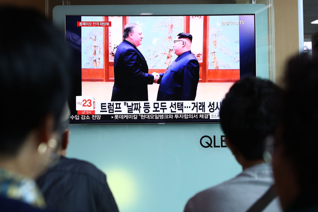 South Koreans watch on a screen reporting the U.S. Secretary of State Mike Pompeo visit to North Korea at the Seoul Railway Station on May 9, 2018 in Seoul, South Korea. The U.S. President Donald Trump announced today that the U.S. Secretary of State Mike Pompeo is on his way to North Korea to finalise plans for the summit with his North Korean counterpart Kim Jong-Un. It is Pompeo's second trip to Pyongyang after a meeting with Kim last month as CIA director.