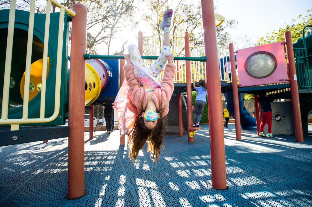 Robin Heilweil, 6, wears a mask while swinging around with her kindergarten class this month at Kenter Canyon School in Los Angeles.