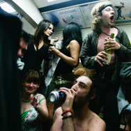 Party revellers enjoy the atmosphere on the London Underground during a Facebook cocktail party on the Circle Line on May 31, 2008 in central London, England.