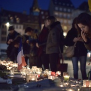 People light candles on November 16, 2015 in Strasbourg, eastern France, to pay tribute to the victims of the attacks in Paris, claimed by Islamic State which killed at least 129 people and left more than 350 injured on November 13.