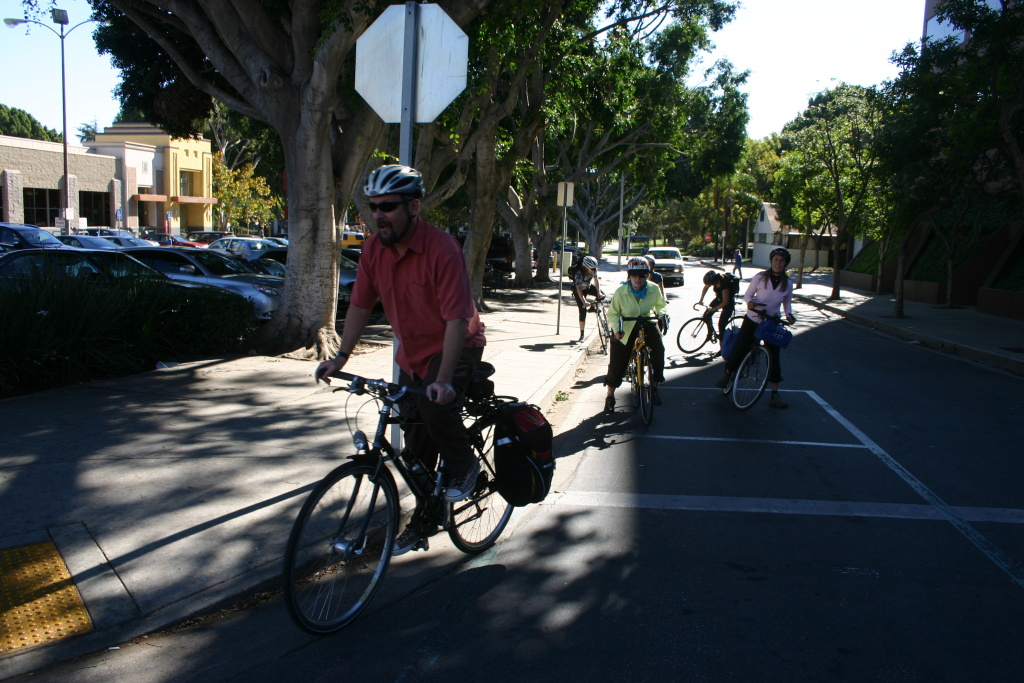 Colin Bogart leads a memorial bike ride from the crash site at Colorado Blvd. and Terrace Dr. to the Pasadena courthouse.