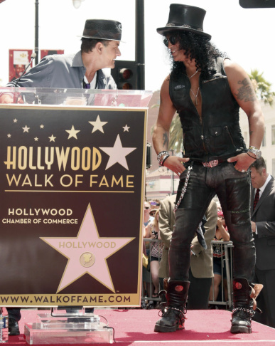 Charlie Sheen introduces Slash at a the Hollywood Walk of Fame Ceremony for Slash on Tuesday, July 10, 2012 in Los Angeles.