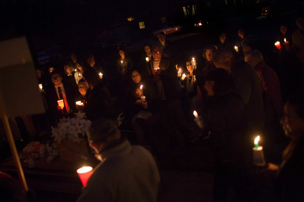 Southern Californians hold a vigil on December 15 at Glenoaks Park in Glendale for the victims of a mass shooting at an Sandy Hook Elementary School  in Newtown, Conn.