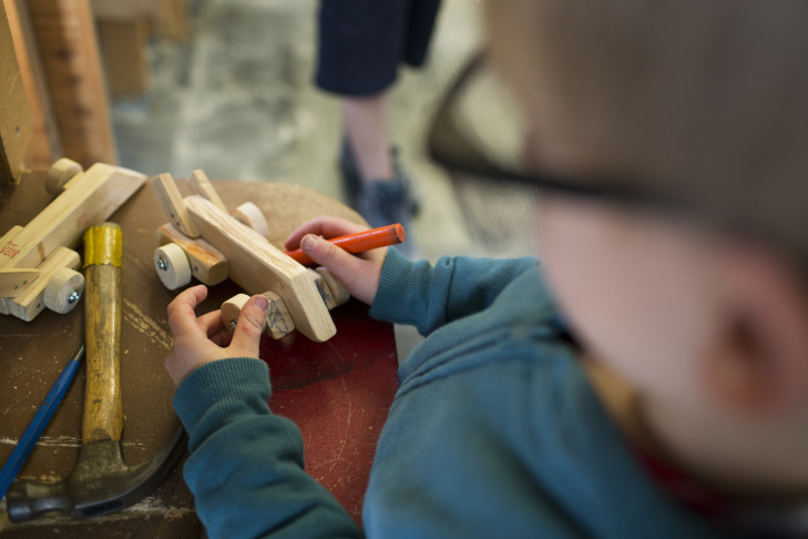 Emmett Joanou, 5, saws a propeller at Side Street Projects in Pasadena on Thursday, May 7, 2015. The mobile arts program serves more than 2,500 children each year.