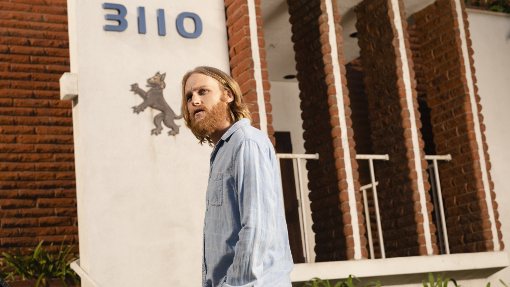Signs and Portents: Dud (Wyatt Russell) prepares to cross the threshold in <em>Lodge 49</em>.