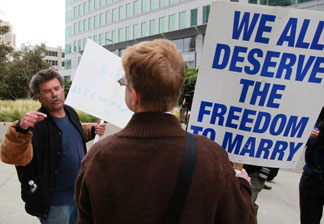 Prop 8 supporter Mark Wassberg (L) argues with Prop 8 opponent Ron Weaver as they waited to hear the ruling on Prop 8 outside of the Philip Burton Federal building August 4, 2010 in San Francisco, California.