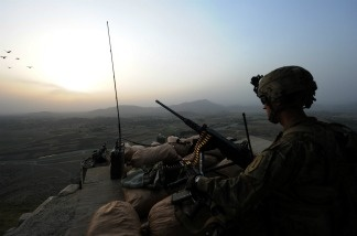 A US soldier from Viper Company (Bravo), 1-26 Infantry, stands guard on a watch tower overlooking villages at Combat Outpost (COP) Sabari in Khost province in the east of Afghanistan.