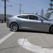 Tesla Motors Chairman and CEO Elon Musk (in driver's seat) and chief designer Franz von Holzhausen (in passenger seat) drive the new Tesla Model S all-electric sedan  in Hawthorne, California on March 26, 2009.