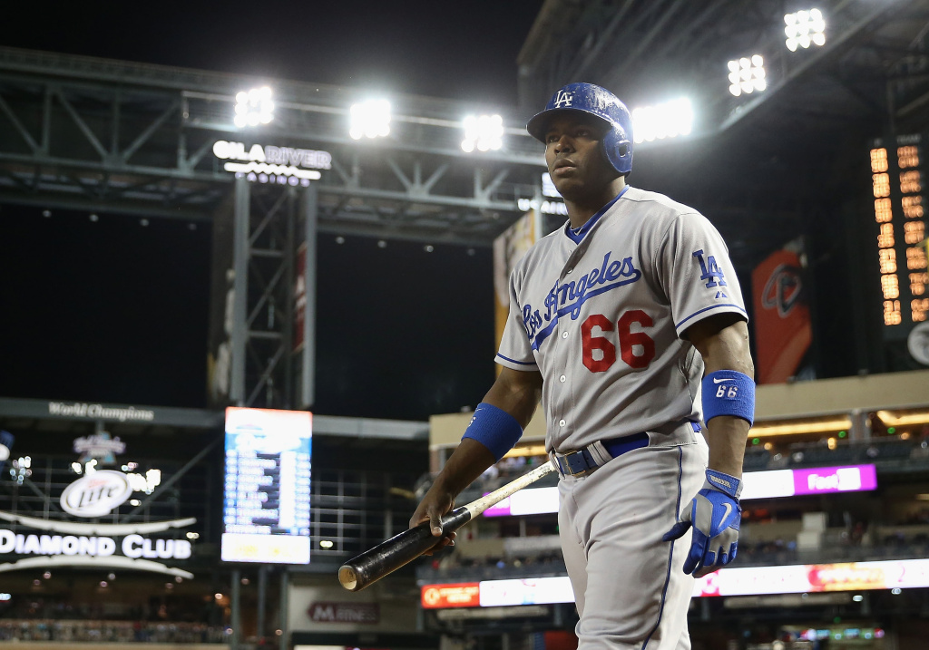 Yasiel Puig #66 of the Los Angeles Dodgers warms up on deck during the MLB game against the Arizona Diamondbacks at Chase Field on Sept. 18, 2013 in Phoenix, Arizona.