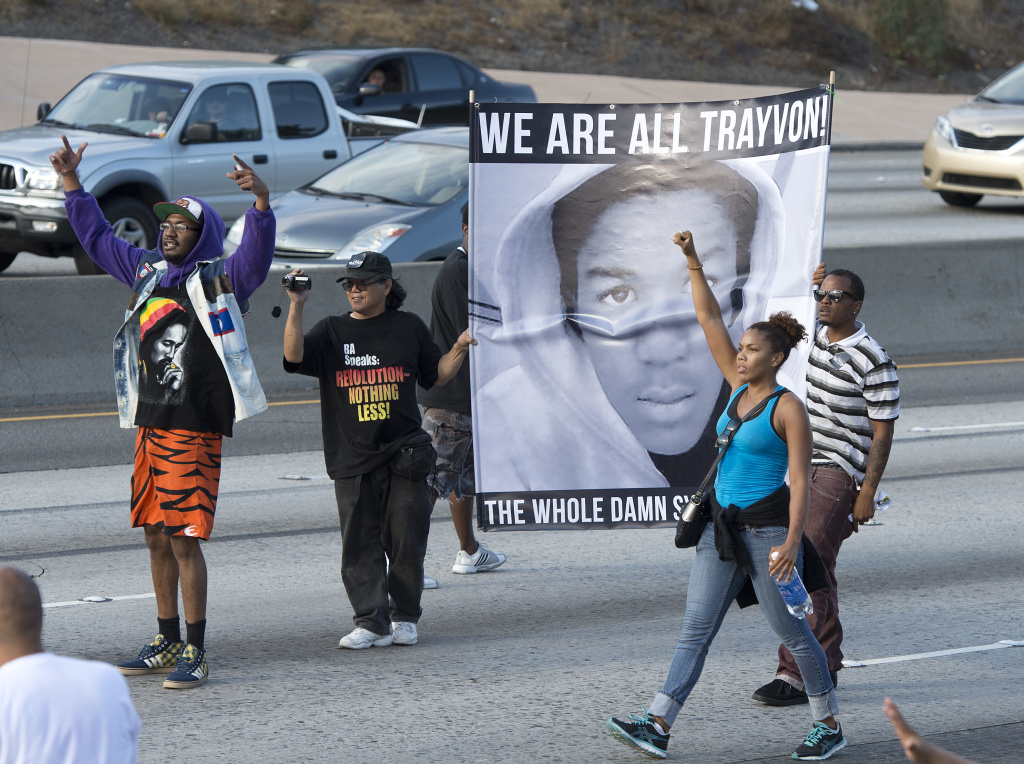 Demonstrators angry at the acquittal of George Zimmerman in the 2012 shooting death of Trayvon Martin in Florida protest on the 10 Freeway stopping traffic in Los Angeles, California July 14, 2013. The federal Justice Department says it will reopen an investigation into whether the shooting was a possible hate crime.
