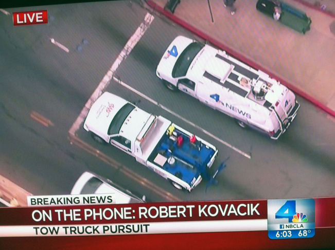 A reporter from NBC talks to the tow truck driver who tells him
