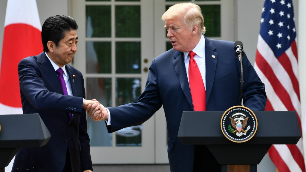 President Trump shakes hands with Japanese Prime Minister Shinzo Abe during a joint press conference in the Rose Garden of the White House on Thursday.