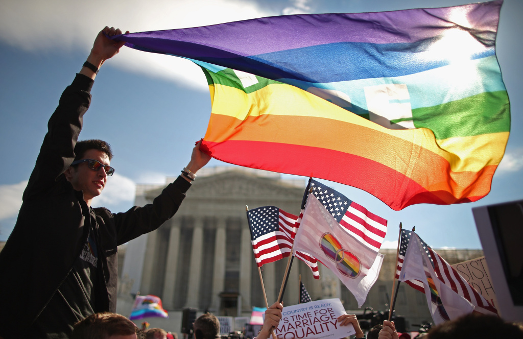 Eric Breese (L) of Rochester, New York, joins fellow George Washington University students and hundreds of others to rally outside the Supreme Court during oral arguments in a case challenging the Defense of Marriage Act (DOMA) March 27, 2013 in Washington, DC.