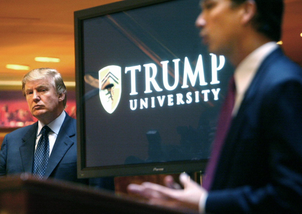 Donald Trump listens as Michael Sexton introduces him at a May 23, 2005, news conference in New York where he announced the establishment of Trump University.