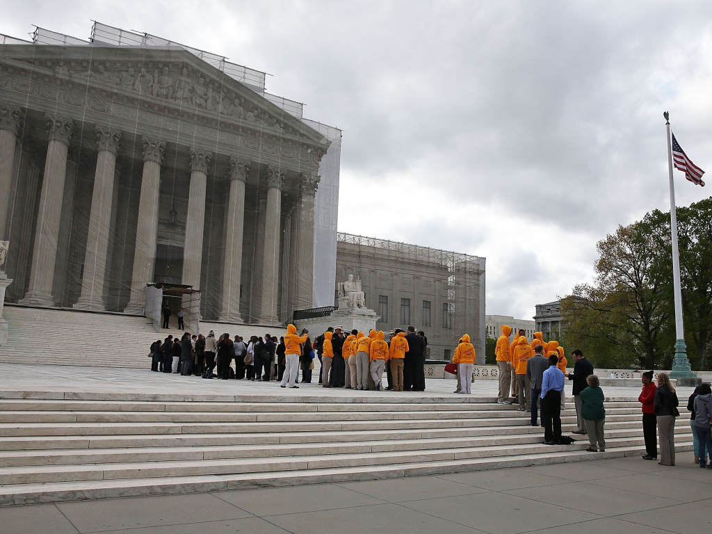 People line up to enter the United States Supreme Court Building last week.