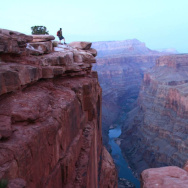 A hiker gazes 3,000 feet down to the Colorado River at Toroweap Overlook in Grand Canyon National Park.