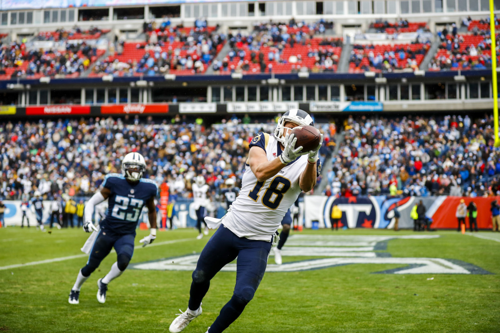 Wide Receiver Cooper Kupp  #18 of the Los Angeles Rams makes a catch for a touchdown against the Tennessee Titans at Nissan Stadium on December 24, 2017 in Nashville, Tennessee.