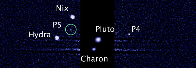 This image, taken by NASA's Hubble Space Telescope, shows five moons orbiting the distant, icy dwarf planet Pluto. The green circle marks the newly discovered moon, designated P5, as photographed by Hubble's Wide Field Camera 3 on July 7.
