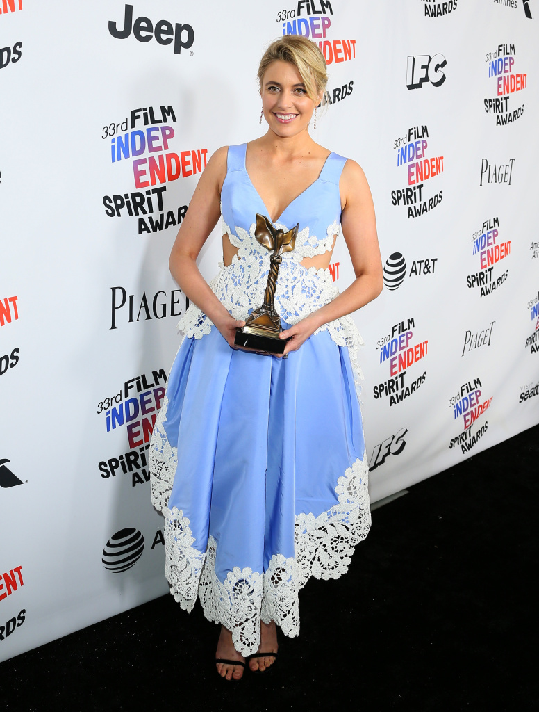Greta Gerwig poses with her Best Screenplay Award for