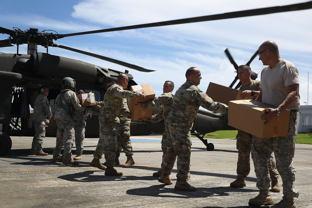 Puerto Rican National Guardsmen load a helicopter with food and water for survivors of Hurricane Maria on September 29, 2017 in San Juan, Puerto Rico.