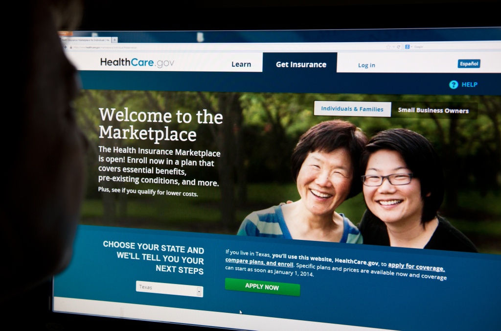 A woman looks at the HealthCare.gov insurance exchange internet site.