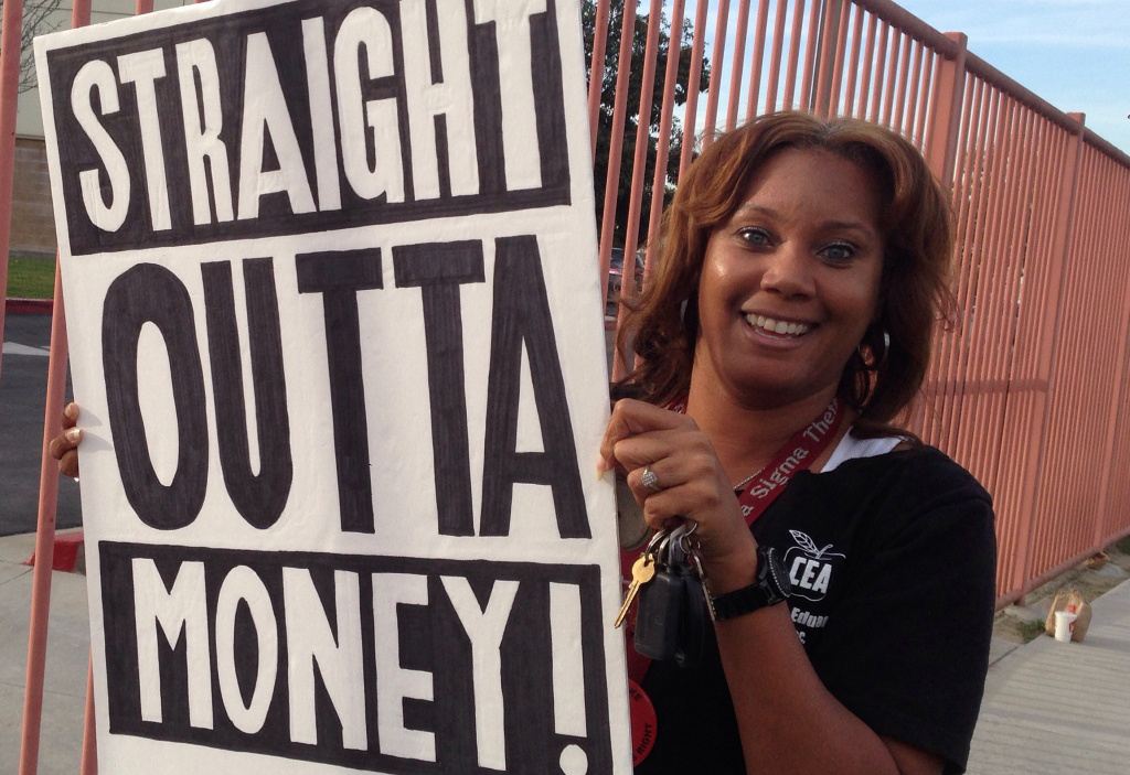 Compton second grade teacher Tamara Carter protests for a pay increase at school district headquarters.