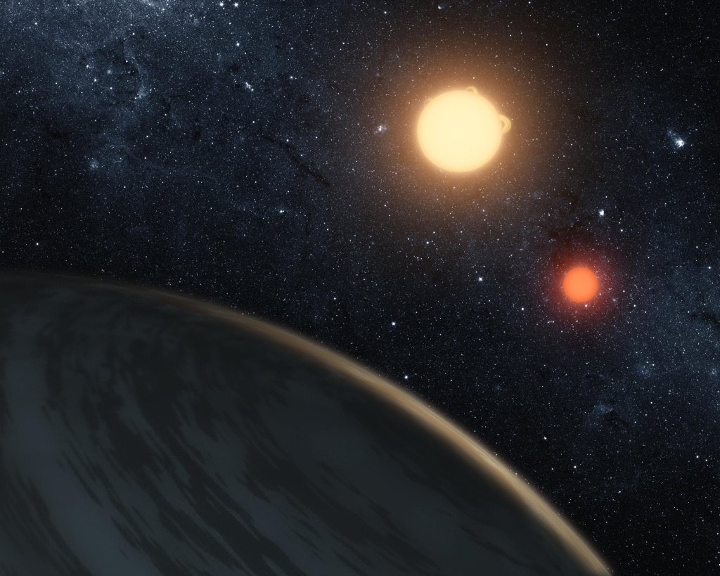 In this digital illustration released on September 15, 2011 by NASA, the newly-discovered gaseous planet Kepler-16b orbits it's two stars.