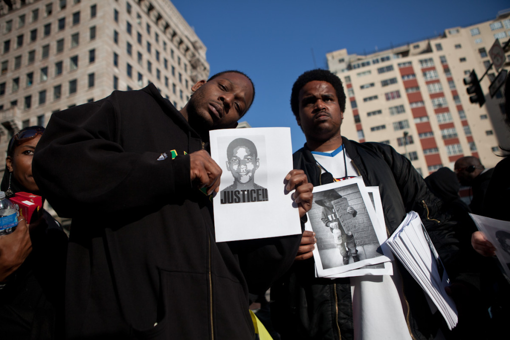 Tony and Matt Capone hold homemade signs at in support of Trayvon Martin.