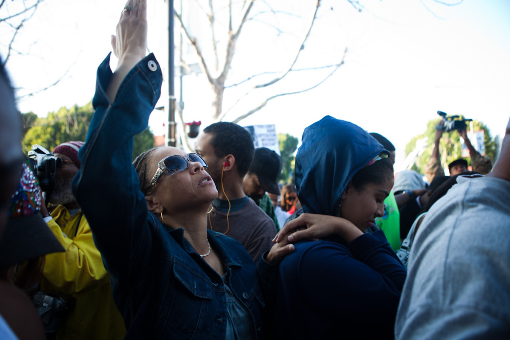 One of the women at the Trayvon Martin rally prays to God during the event.