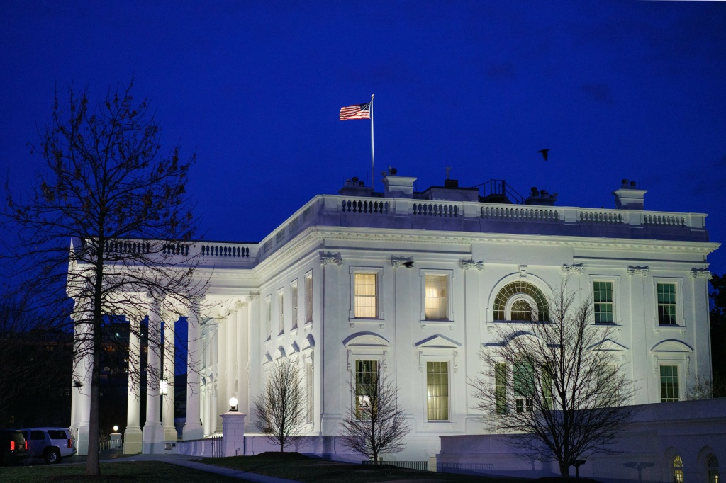 The White House is seen after sunset in Washington, DC on January 23, 2019.