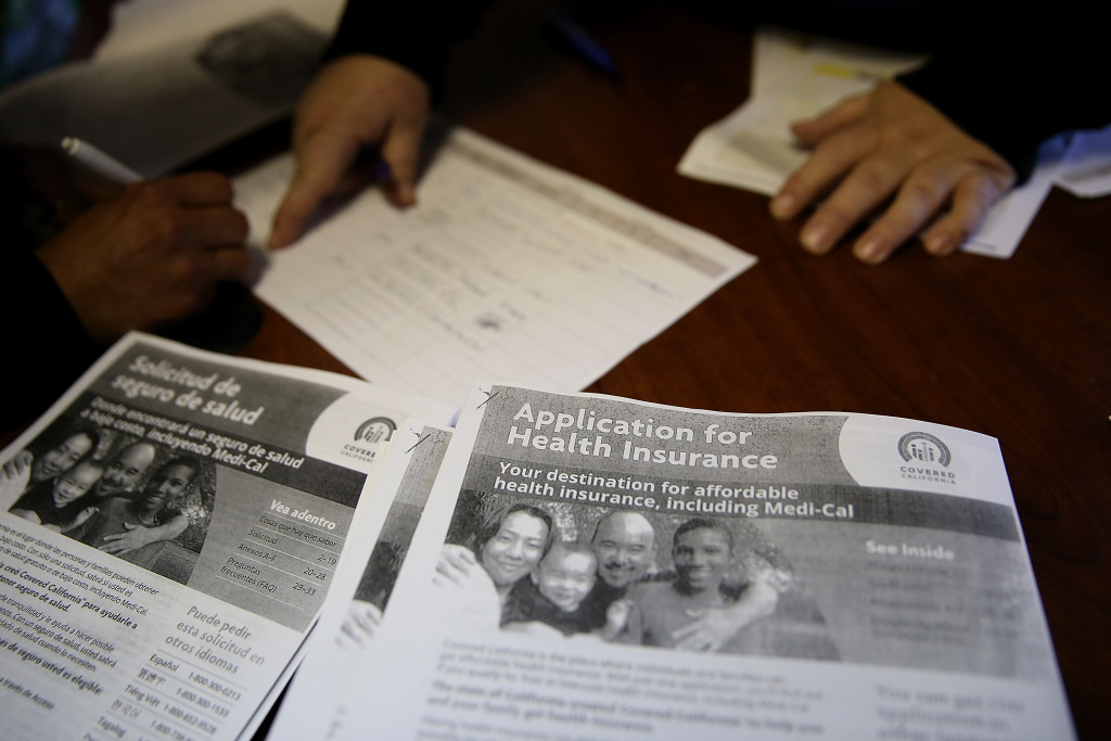 Informational pamphlets are displayed during a healthcare enrollment fair at the Bay Area Rescue Mission on March 31, 2014 in Richmond, California. SEIU-United Healthcare Workers West (SEIU-UHW) held the fair to help people sign up for free and low-cost health coverage through Medi-Cal or Covered California.