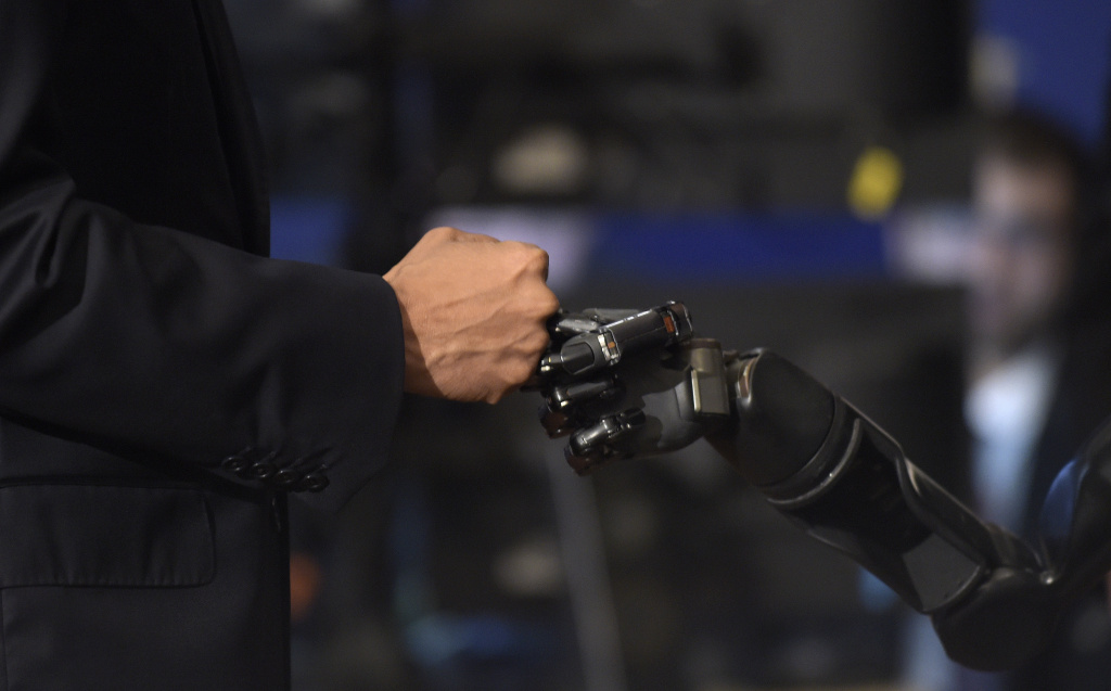 President Barack Obama bumped fists with Nathan Copeland during a tour of innovation projects at the White House Frontiers Conference at the University of Pittsburgh in 2016.