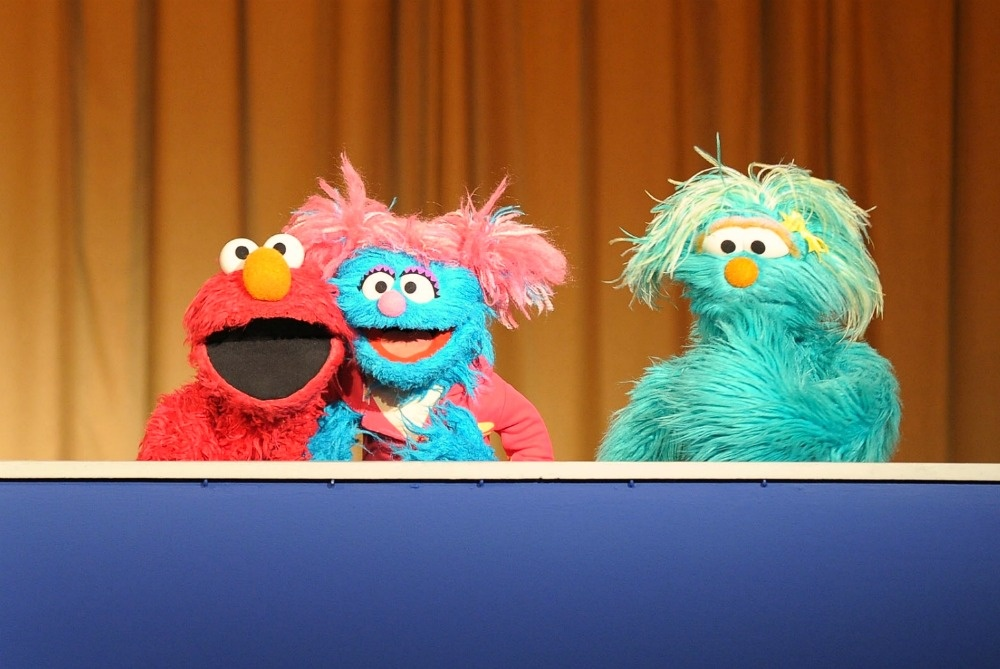 Sesame Street Muppets (L-R) Elmo, Jesse and Rosita address an audience and the press at Madison Square Park on April 8, 2010 in New York City.
