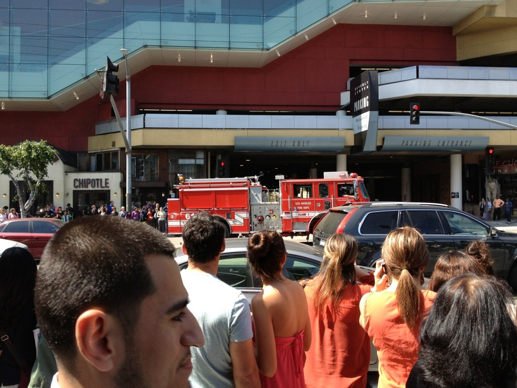 A fire truck speeds by headed toward Beverly Boulevard during a Beverly Center evacuation Sunday, March 24 following a suspicious package being found in the parking garage.