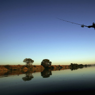 A fisherman casts his line into the Sacramento River in the Sacramento-San Joaquin River Delta on September 29, 2005.