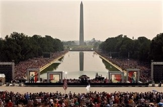Thousands of people fill the National Mall for a political rally.
