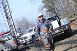 A Massey worker walks above above Massey Energy's Upper Big Branch Coal Mine April 7, 2010 in Montcoal, West Virginia.
