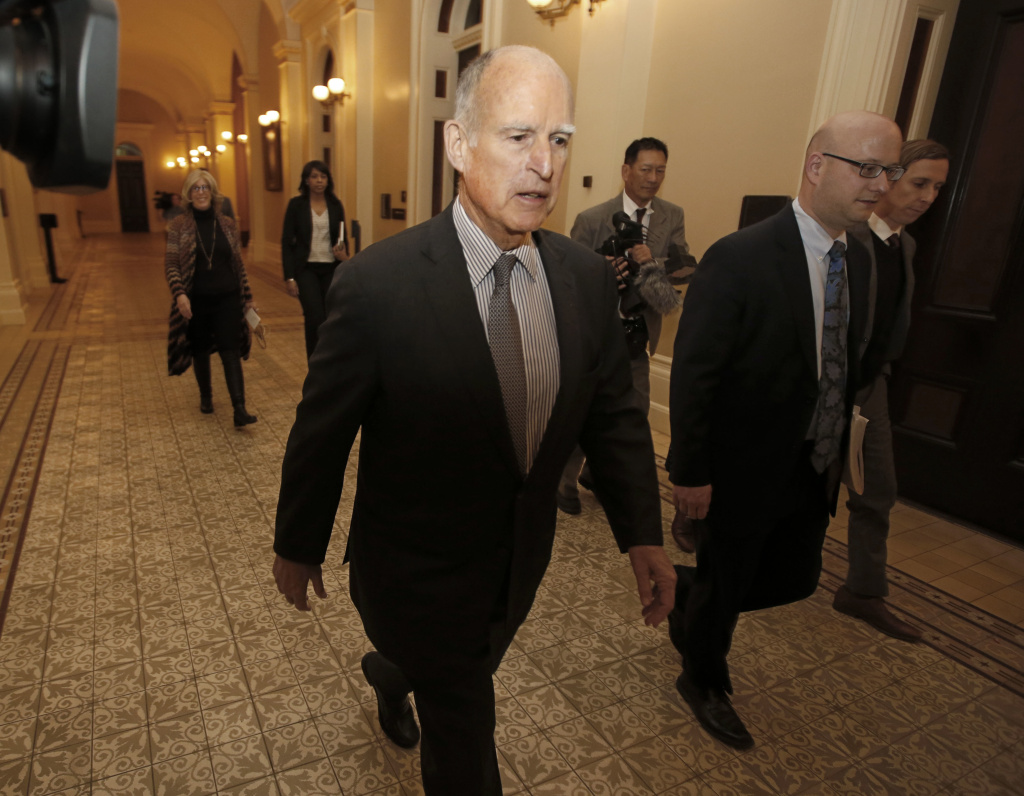 California Gov. Jerry Brown returns to his office after meeting with the Senate Democratic Caucus to urge them to approve a transportation plan, Thursday, April 6, 2017, in Sacramento, Calif. Brown and top legislative leaders pressed all week to convince fellow Democrats to support the measure that would place a $5-billion-a-year boost in California's gas and vehicle taxes to pay for major road repairs. (AP Photo/Rich Pedroncelli)