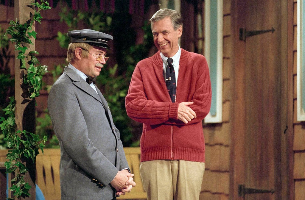 Fred Rogers, right, turned
