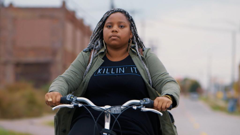 Dextina Booker rides her bike to work in Detroit in