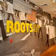Roots exhibit title wall