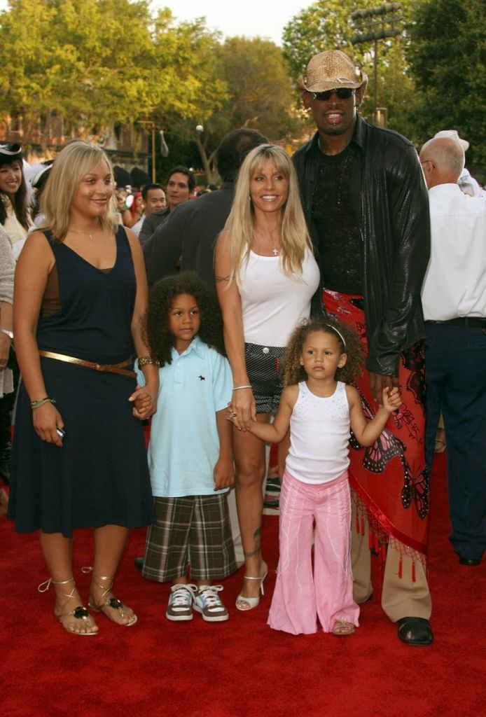 "Dennis Rodman with then-wife Michelle Moyer and kids arrive at the world premiere of ""Pirates of the Caribbean 2: Dead Man's Chest"" held at Disneyland on June 24, 2006 in Anaheim."