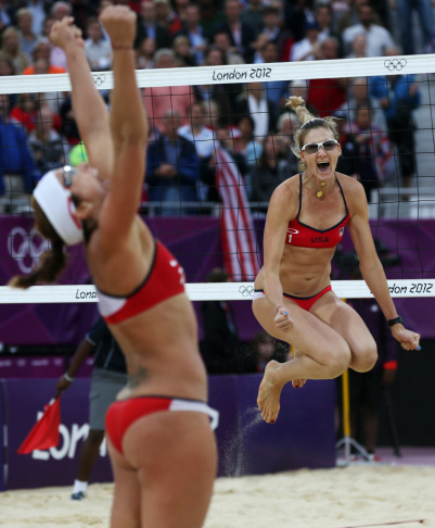 The United States Jennifer Kessy, left, and April Ross celebrate after beating top seeded Brazil during a women's semifinal beach volleyball match at the 2012 Summer Olympics, Tuesday, Aug. 7, 2012, in London.